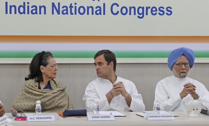 FILE- In this Saturday, May 25, 2019, file photo, Congress party leader Sonia Gandhi, left, her son and party President Rahul Gandhi, center, and former Indian Prime Minister Manmohan Singh attend a Congress Working Committee meeting in New Delhi, India. India's main opposition Congress party appears to be drifting rudderless as it faces a crucial political test in two key state elections later in October, after a severe drubbing at the hands of Prime Minister Narendra Modi's Hindu nationalist party in the May national elections. (AP Photo/Altaf Qadri)