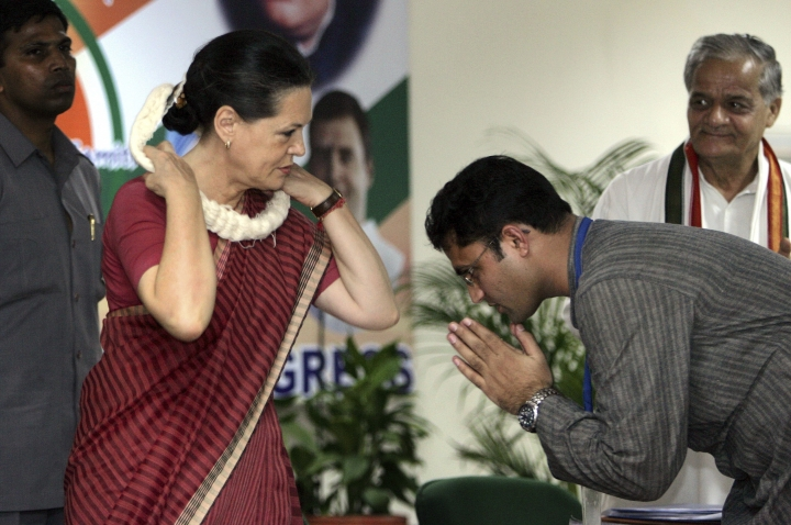 FILE - In this Wednesday, July 26, 2006, file photo, Indian Youth Congress President Ashok Tanwar, right, greets Congress party President Sonia Gandhi at a three day national training conference of congress party district presidents, in New Delhi, India. India's main opposition Congress party appears to be drifting rudderless as it faces a crucial political test in two key state elections in October, 2019, after a severe drubbing at the hands of Prime Minister Narendra Modi's Hindu nationalist party in the May national elections. Tanwar, Haryana state party chief where voting will be held on Oct. 21, quit following difference with party's leadership over choice of candidates for voting districts. (AP Photo/Manish Swarup, File)