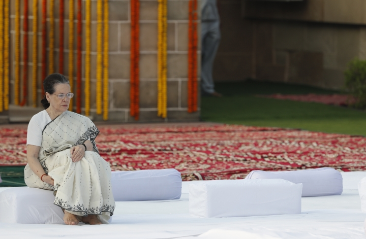 FILE - In this Wednesday, Oct. 2, 2019, file photo, India's main opposition Congress party leader Sonia Gandhi pays tribute to iconic independence leader Mahatma Gandhi on the 150th anniversary of his birth at Rajghat, the Gandhi memorial in New Delhi, India. The current state of India's main opposition Congress party is so dire, a senior party leader says it is losing so many members and support it may not be able to win upcoming state elections or ensure its own future. Party president Rahul Gandhi left after the May defeat in the general elections. His mother, Sonia Gandhi, stepped in on an interim basis. (AP Photo/Manish Swarup)