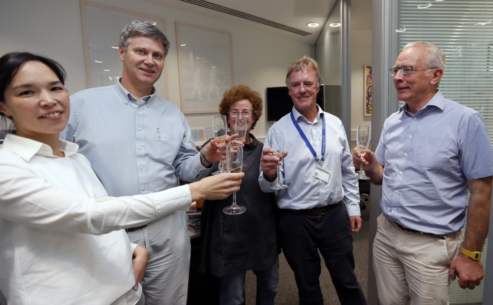 Scientist Peter J.Ratcliffe, second from right, celebrates with his team at the University in Oxford, England, Monday, Oct. 7, 2019. Two Americans and a British scientist won the 2019 Nobel Prize for Physiology or Medicine for discovering how the body's cells sense and react to oxygen levels, work that has paved the way for new strategies to fight anemia, cancer and other diseases Drs. William G. Kaelin Jr. of Harvard University, Gregg L. Semenza of Johns Hopkins University and Peter J. Ratcliffe at the Francis Crick Institute in Britain and Oxford University will share the 9 million kronor ($918,000) cash award.(AP Photo/Frank Augstein)