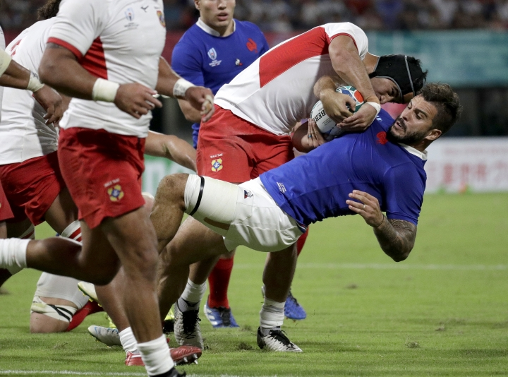 France's Sofiane Guitoune is tackled by a Tongan defender during the Rugby World Cup Pool C game at Kumamoto Stadium between France and Tonga in Kumamoto, Japan, Sunday, Oct. 6, 2019. (AP Photo/Aaron Favila)