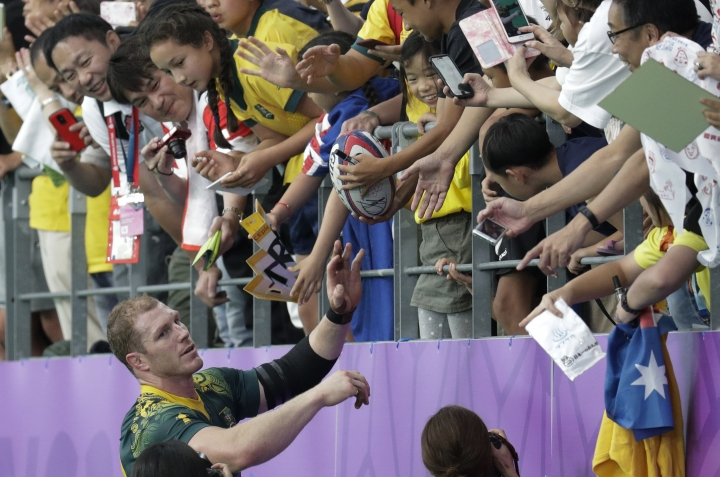 Australia's David Pocock greets the crowd following their Rugby World Cup Pool D game against Uruguay at Oita Stadium in Oita, Japan, Saturday, Oct. 5, 2019. Australia defeated Uruguay 45-10. (AP Photo/Aaron Favila)