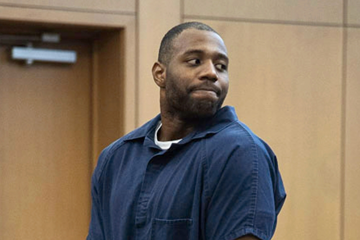 FILE - In this March 27, 2019, file photo, Torrey Green looks back to his family during his sentencing in Brigham City, Utah. Two women raped by the former Utah State University football player are suing the university. The Salt Lake Tribune reports the lawsuit filed Monday, Oct. 7, 2019, in U.S. District Court claims the school fostered an environment where sexual assaults were tolerated. Green was sentenced in March to 26 years to life in prison for sexually assaulting six women he dated between 2013 and 2015. (Chantelle McCall/The Utah Statesman, Pool, File)