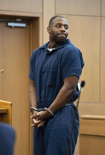 FILE - In this March 27, 2019, file photo, Torrey Green looks back to his family during his sentencing in Brigham City, Utah.Two women raped by the former Utah State University football player are suing the university. The Salt Lake Tribune reports the lawsuit filed Monday, Oct. 7, 2019, in U.S. District Court claims the school fostered an environment where sexual assaults were tolerated. Green was sentenced in March to 26 years to life in prison for sexually assaulting six women he dated between 2013 and 2015. (Chantelle McCall/The Utah Statesman, Pool, File)
