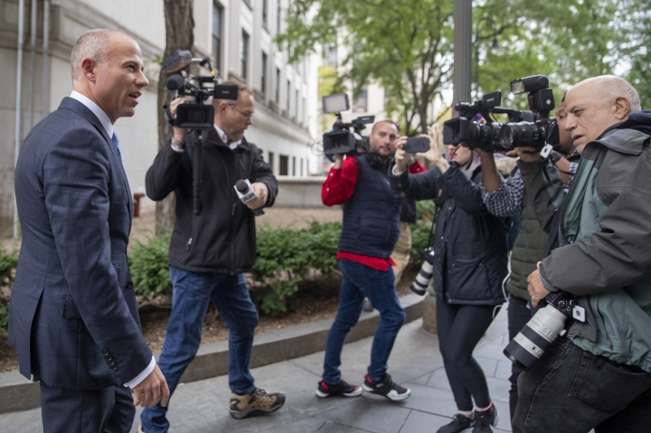 Attorney Michael Avenatti, left, is surrounded by photographers as he leaves Manhattan Federal court, Tuesday, Oct. 8, 2019, in New York. (AP Photo/Mary Altaffer)