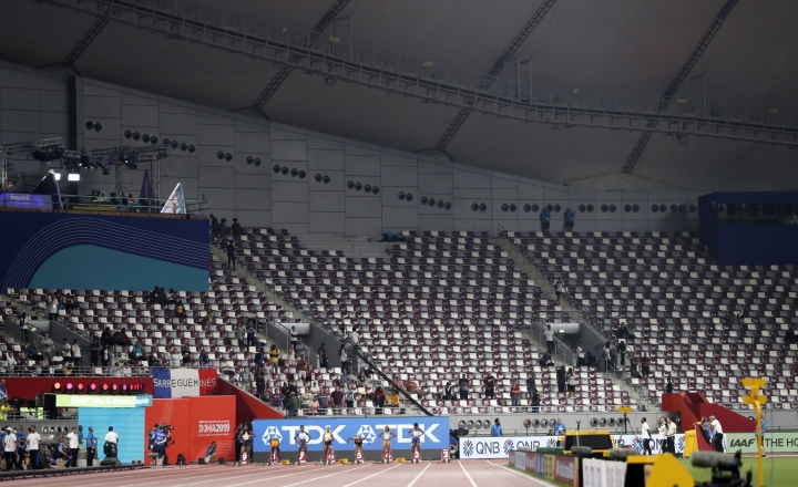 Empty seats before the the women's 100 meter final at the World Athletics Championships in Doha, Qatar, Sunday, Sept. 29, 2019. (AP Photo/Petr David Josek)