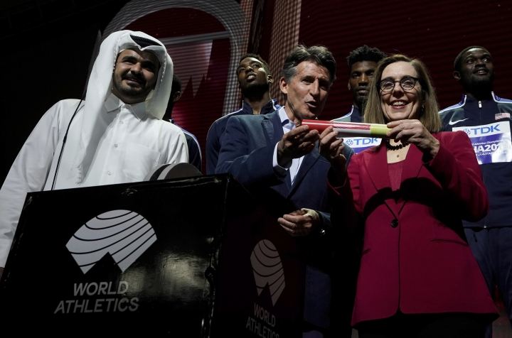 Sheikh Joaan bin Hamad bin Khalifa Al Thani, IAAF President Sebastian Coe hands over a ceremonial baton to Oregon Governor Kate Brown pose at the closing ceremony for the World Athletics Championships in Doha, Qatar, Sunday, Oct. 6, 2019. (AP Photo/Morry Gash)