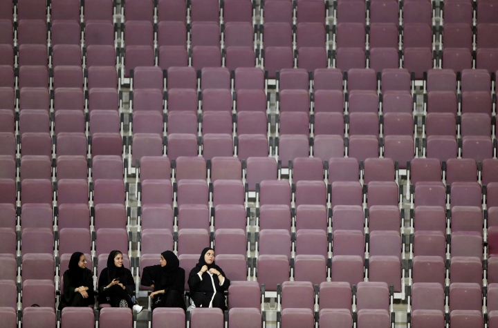 Spectators sit in nearly empty seats the World Athletics Championships in Doha, Qatar, Monday, Sept. 30, 2019. (AP Photo/Hassan Ammar)