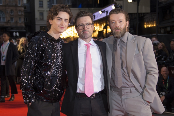 """FILE - This Oct. 3, 2019 file photo shows Timothee Chalamet, left, and Joel Edgerton, right, with director David Michôd at the premiere of the """"The King"""" during the London Film Festival, in central London. Chalamet portrays King Henry V in the period drama in theaters this week. (Photo by Vianney Le Caer/Invision/AP, File)"""