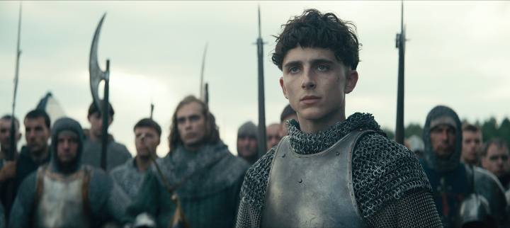 "This image released by Netflix shows Timothée Chalamet, center, in a scene from ""The King."" (Netflix via AP)"