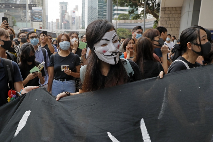 Supporters of Hong Kong activist Edward Leung gather outside the High Court in Hong Kong, Wednesday, Oct. 9, 2019. Last year, Leung was sentenced to six years in prison for his part in a violent nightlong clash with police over illegal street food hawkers two years ago. (AP Photo/Kin Cheung)