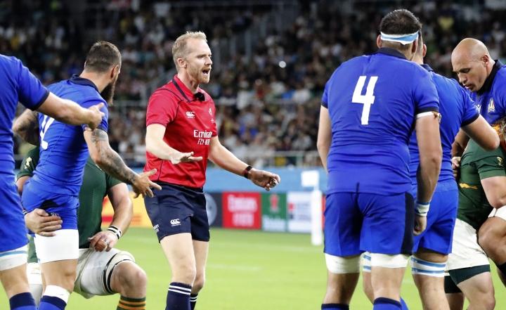 Referee Wayne Barnes gestures to the players during the Rugby World Cup Pool B game at Shizuoka Stadium Ecopa between South Africa and Italy, in Shizuoka, Japan, Friday, Oct. 4, 2019. (AP Photo/Shuji Kajiyama)