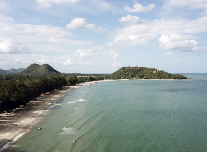 This June 15, 2019 photo shows Ban Krut beach in the Prachuap Khiri Khan province of Thailand. You won't find the party scene of Phuket or Pattaya in laid-back Ban Krut, but you will get one of the cleanest and quietest stretches of white sand within driving distance of the capital. (AP Photo/Nicole Evatt)