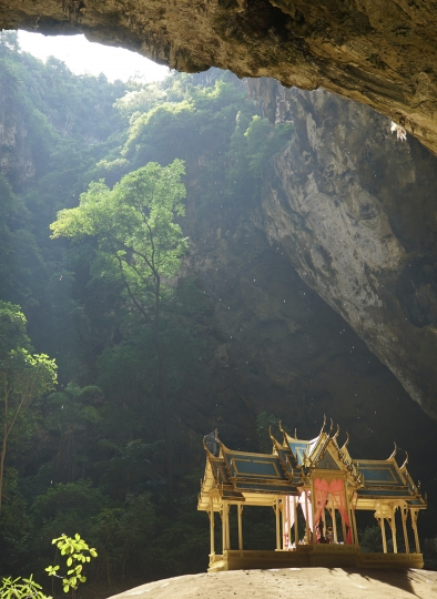 This Nov. 17, 2018 photo shows the royal pavilion drenched in sunlight inside the Phraya Nakhon Cave located in Thailand's Khao Sam Roi Yot National Park. Its lush hiking trails, wetlands and mangrove forests make Khao Sam Roi Yot National Park a weekend adventure worthy of topping your Thailand to-do list. (AP Photo/Nicole Evatt)