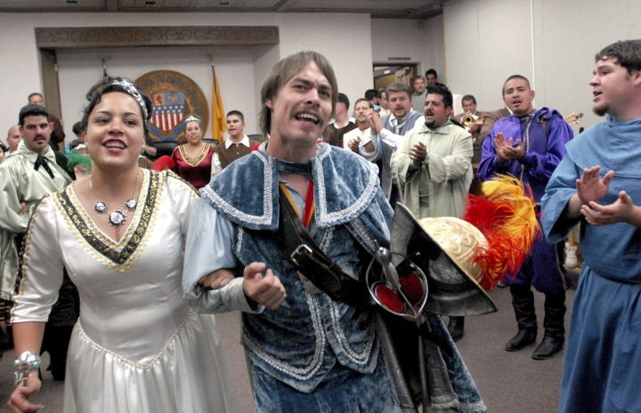 FILE - In this Sept. 5, 2006, file photo, Jessica Lucero, left, dressed as the Fiesta Queen, and Jaime Dean, right, dressed as 17th Century Spanish conquistador Don Diego de Vargas, dance and sing at Santa Fe City Hall in Santa Fe, N.M. In recent years, the conquistador and all the effigies connected to it have come under intense criticism from Native American activists who say the image glorifies indigenous genocide and needs to be removed from schools, streets and seals. (AP Photo/Jeff Geissler,File)