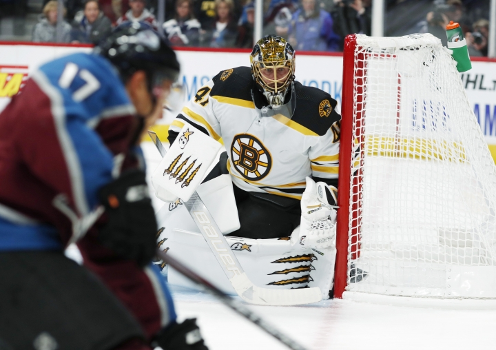 Boston Bruins goaltender Jaroslav Halak protects the net as Colorado Avalanche center Tyson Jost drives in for a shot during the third period of an NHL hockey game Thursday, Oct. 10, 2019, in Denver. Colorado won 4-2. (AP Photo/David Zalubowski)