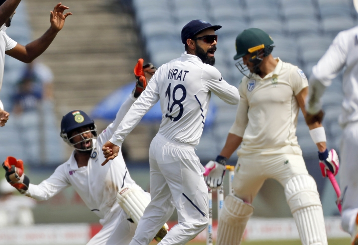 India's Virat Kohli celebrates celebrates the wicket of South Africa's Faf du Plessis during the fourth day of second cricket test match between India and South Africa in Pune, India, Sunday, Oct. 13, 2019. (AP Photo/Rajanish Kakade)