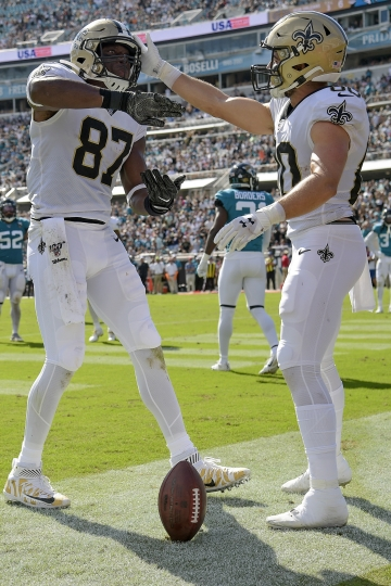 New Orleans Saints tight end Jared Cook (87) celebrates his touchdown catch against the Jacksonville Jaguars with wide receiver Austin Carr, right, during the second half of an NFL football game, Sunday, Oct. 13, 2019, in Jacksonville, Fla. (AP Photo/Phelan M. Ebenhack)