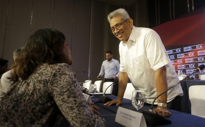 Sri Lankan presidential candidate and former defense chief Gotabaya Rajapaksa speaks with a journalist after a news conference in Colombo, Sri Lanka, Tuesday, Oct. 15, 2019. Rajapaksa, who's a front-runner in next month's presidential election says if he wins he won't recognize an agreement the government made with the U.N. human rights council to investigate alleged war crimes during the nation's civil war. (AP Photo/Eranga Jayawardena)