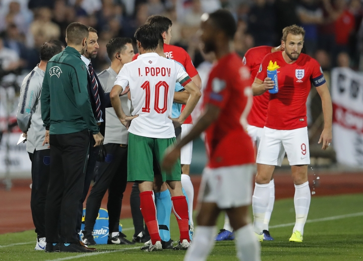 England manager Gareth Southgate, third left, speaks with Referee Ivan Bebek during the Euro 2020 group A qualifying soccer match between Bulgaria and England, at the Vasil Levski national stadium, in Sofia, Bulgaria, Monday, Oct. 14, 2019. (AP Photo/Vadim Ghirda)