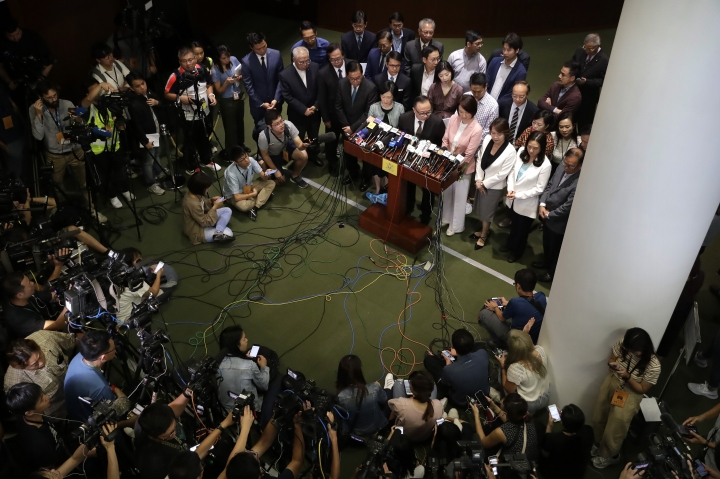 Pro-Beijing legislators speak during a press conference after Hong Kong Chief Executive Carrie Lam left the Legislative Council in Hong Kong, Wednesday, Oct. 16, 2019. In chaotic scenes, furious pro-democracy lawmakers twice forced Hong Kong's leader to stop delivering a speech laying out her policy objectives and clamored for her to resign after she walked out of the legislature on Wednesday and then delivered the annual address 75 minutes late via television. (AP Photo/Mark Schiefelbein)
