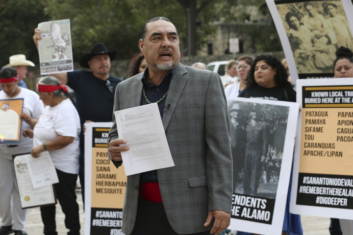 Ramon Vasquez, executive director of American Indians in Texas at the Spanish Colonial Missions, addresses the media during a news conference by the U.S. Postal Service building across the Alamo, Monday, Oct. 14, 2019 in San Antonio. A Native American group is calling on officials to slow down the renovation of the Alamo church in San Antonio, after archaeological reports showed human remains were found at the property. (Jerry Lara/The San Antonio Express-News via AP)