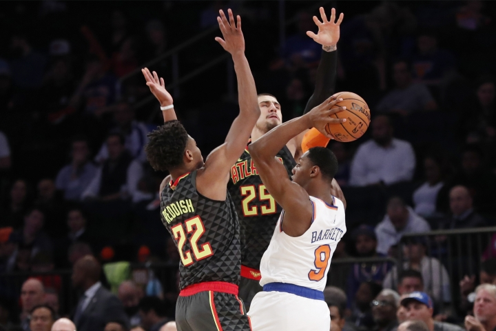 New York Knicks forward RJ Barrett (9) looks to pass with Atlanta Hawks forward Cam Reddish (22) and center Alex Len (25) defending during the first half of a preseason NBA basketball game in New York, Wednesday, Oct. 16, 2019. (AP Photo/Kathy Willens)