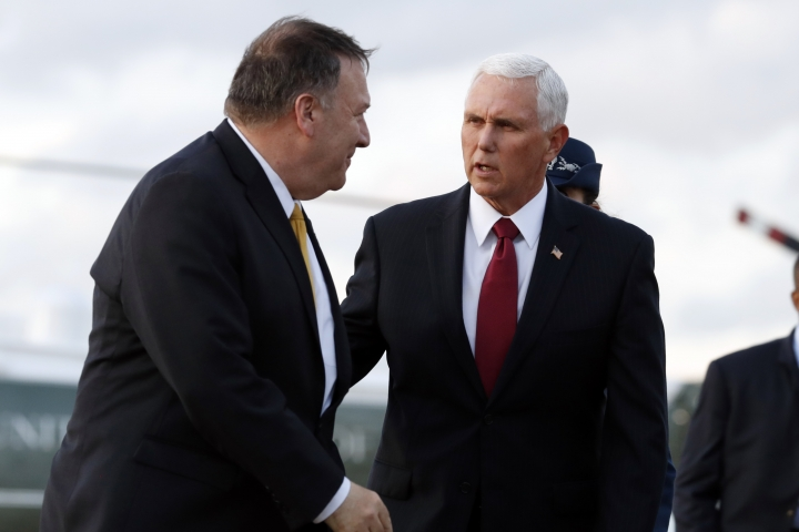 Vice President Mike Pence and Secretary of State Mike Pompeo arrive at Andrews Air Force Base, Md., Wednesday, Oct. 16, 2019, as they depart en route to Turkey. (AP Photo/Jacquelyn Martin)