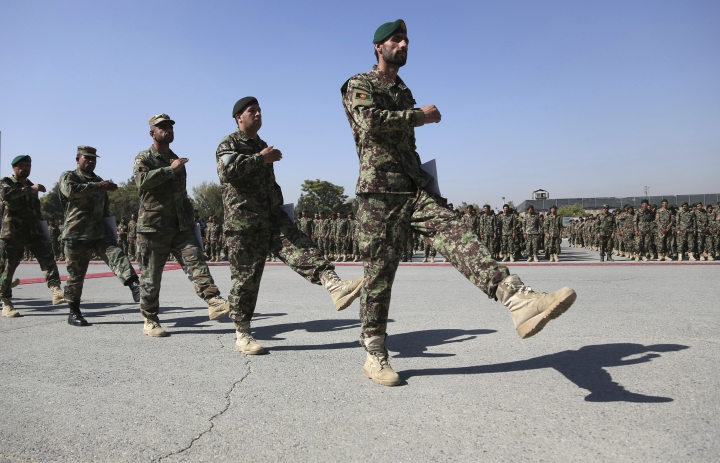Newly graduated Afghan National Army march during their graduation ceremony after a three month training program at the Afghan Military Academy in Kabul, Afghanistan, Sunday, Oct. 13, 2019. (AP Photo/Rahmat Gul)