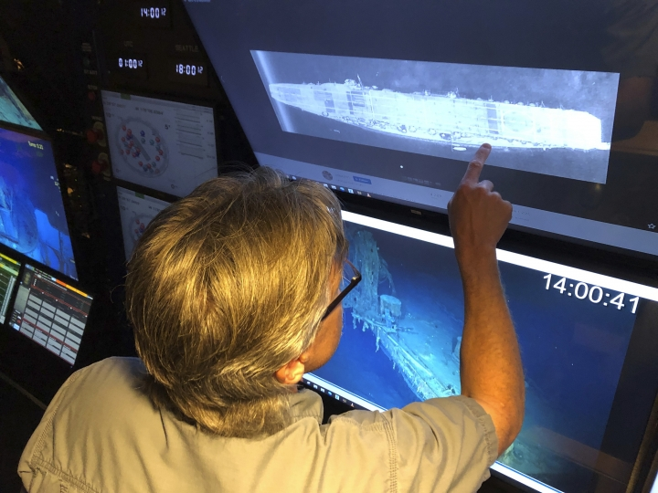 In this Wednesday, Oct. 16, 2019, photo,Vulcan Inc. director of subsea operations for the Petrel, Rob Kraft looks at images of the Japanese aircraft carrier Kaga, off Midway Atoll in the Northwestern Hawaiian Islands. Deep-sea explorers scouring the world's oceans for sunken World War II ships are honing in on a debris field deep in the Pacific. The research vessel called the Petrel is launching underwater robots about halfway between the U.S. and Japan in search of warships from the Battle of Midway. (AP Photo/Caleb Jones)