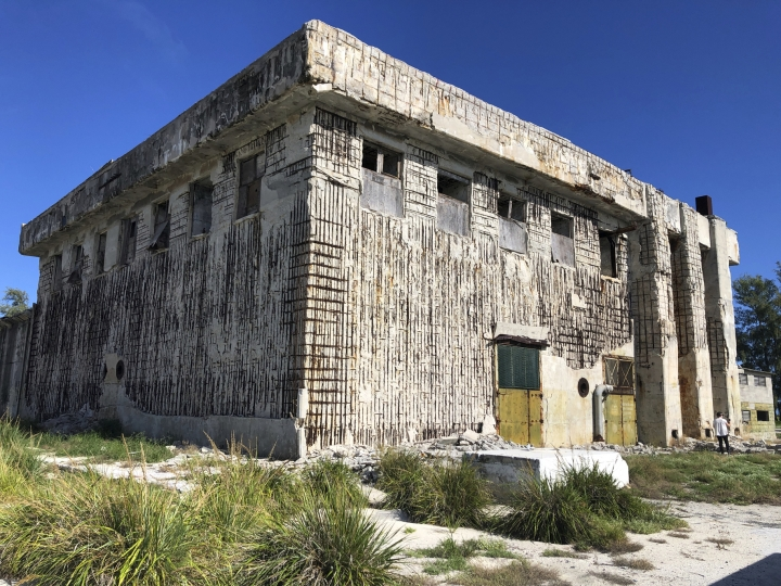 In this Tuesday, Oct. 15, 2019 photo, a damaged World War II building is shown on Midway Atoll in the Northwestern Hawaiian Islands. Researchers scouring the world's oceans for sunken World War II ships are honing in on debris fields deep in the Pacific. A research vessel called the Petrel is launching underwater robots about halfway between the U.S. and Japan in search of warships from the Battle of Midway. (AP Photo/Caleb Jones)