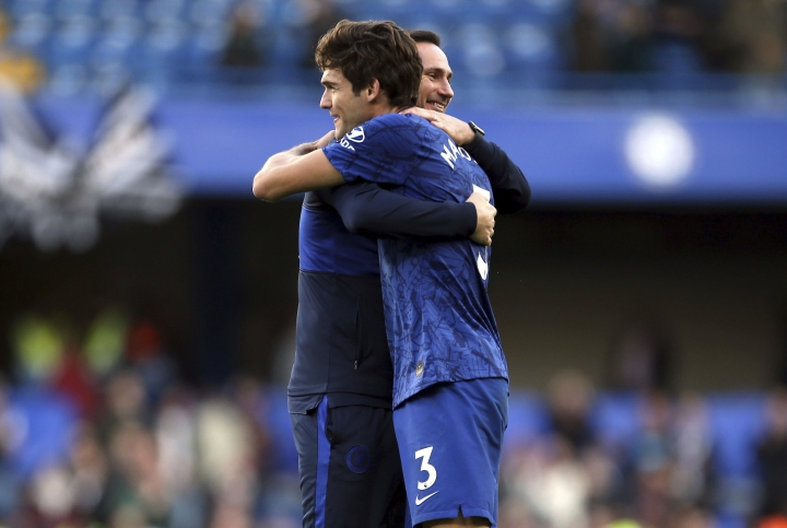 Chelsea manager Frank Lampard and Marco Alonso celebrate their side's 1-0 win after the final whistle of the British Premier League soccer match between Newcastle United and Chelsea, at Stamford Bridge, London, Saturday, Oct. 19, 2019. (Steven Paston/PA via AP)