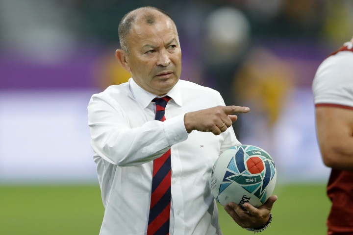 England's coach Eddie Jones gestures ahead of the Rugby World Cup quarterfinal match against Australia at Oita Stadium in Oita, Japan, Saturday, Oct. 19, 2019. (AP Photo/Christophe Ena)