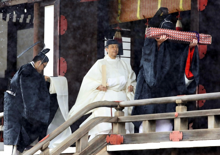 "Japan's Emperor Naruhito, in a white robe, leaves after praying at ""Kashikodokoro"", one of three shrines at the Imperial Palace, in Tokyo, Tuesday, Oct. 22, 2019. Emperor Naruhito visited three Shinto shrines at the Imperial Palace before proclaiming himself Japan's 126th emperor in an enthronement ceremony. (Kyodo News via AP)"