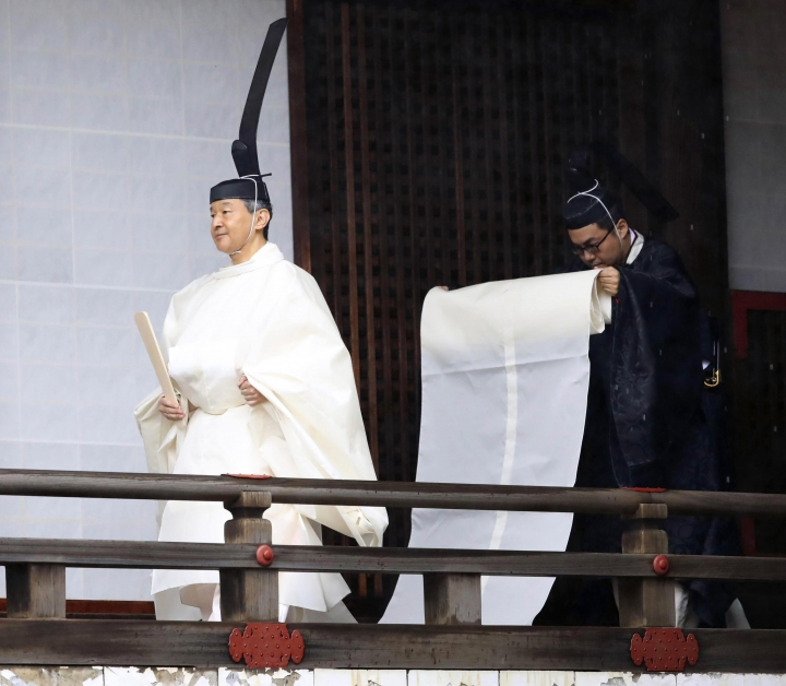 "Japan's Emperor Naruhito, in a white robe, visits ""Kashikodokoro"", a shrine at the Imperial Palace, in Tokyo, Tuesday, Oct. 22, 2019. Emperor Naruhito visited three Shinto shrines at the palace before proclaiming himself Japan's 126th emperor in an enthronement ceremony. (Kyodo News via AP)"