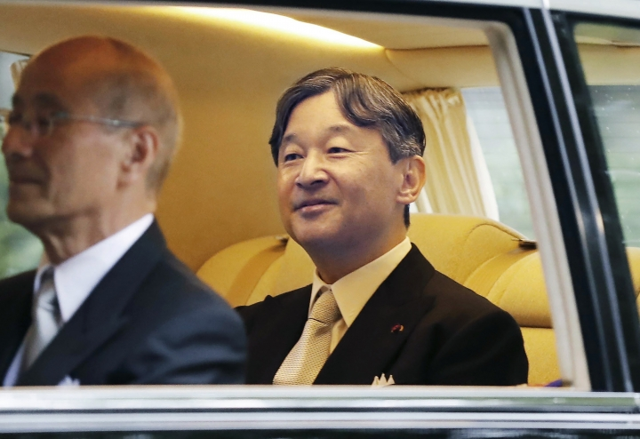 Japan's Emperor Naruhito smiles as he heads to the Imperial Palace in Tokyo, Tuesday, Oct. 22, 2019. Emperor Naruhito will declare Tuesday he had ascended to the Chrysanthemum Throne at the palace. (Kyodo News via AP)
