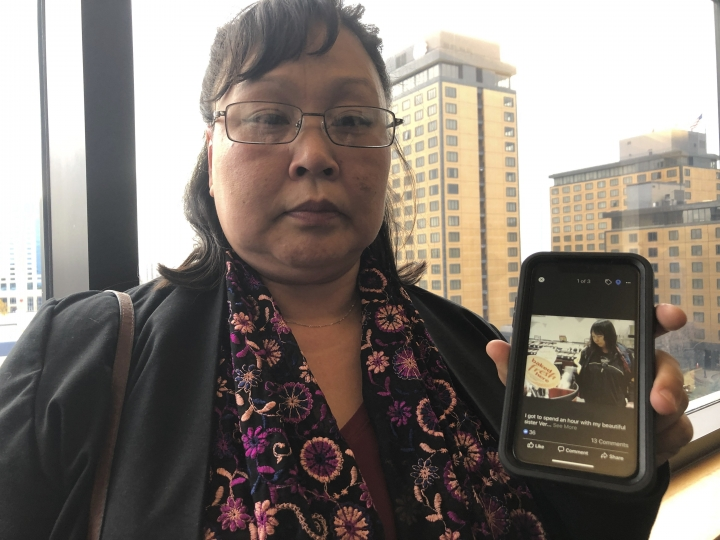 Rena Sapp, outside a courtroom Monday, Oct. 21, 2019, in Anchorage, Alaska, shows a photo of her sister, Veronica Abouchuk, taken during a day out shopping in 2013. Sapp attended the arraignment of Brian Steven Smith, who is accused of killing Abouchuk. (AP Photo/Mark Thiessen)