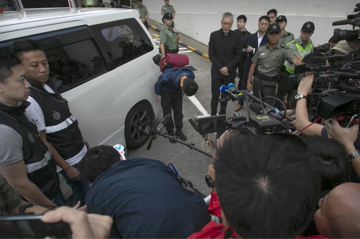 Chan Tong-kai, center, bows after talking to the media as he is released from prison in Hong Kong Wednesday, Oct. 23, 2019. A murder suspect whose case indirectly led to Hong Kong's ongoing protests was freed from prison on Wednesday and told reporters he was willing to surrender to authorities in Taiwan, where he is wanted for the killing of his girlfriend. (AP Photo/Mark Schiefelbein)