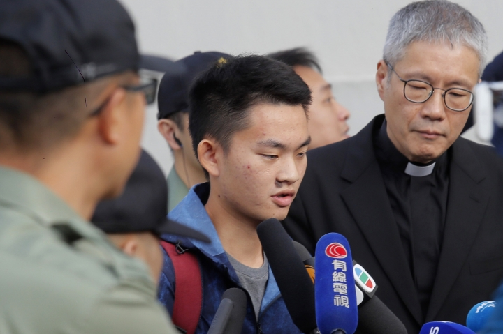 Chan Tong-kai, center, talks to the media as he is released from prison in Hong Kong Wednesday, Oct. 23, 2019. Chan, who's wanted for killing his girlfriend last year on the self-ruled island, had asked the Hong Kong government for help turning himself in to Taiwan after his sentence for money laundering offenses ends on Wednesday. (AP Photo/Kin Cheung)