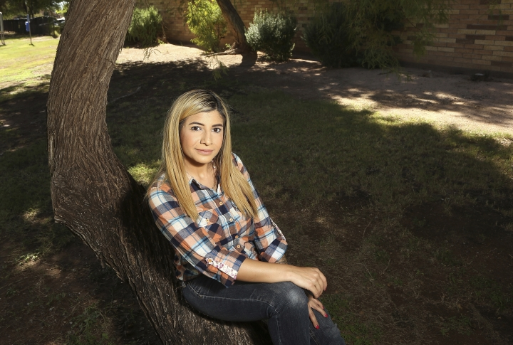 In this Tuesday, Oct. 15, 2019 photo, college student, Sheida Assar, poses for a photo in Chandler, Ariz. Assar said she was expelled from GateWay Community College in Phoenix last month for violating the school's drug policy after she tested positive for marijuana, which she uses to treat chronic pain from polycystic ovary syndrome. Colleges are becoming a battleground in the conflict between federal and state marijuana laws. (AP Photo/Ross D. Franklin)