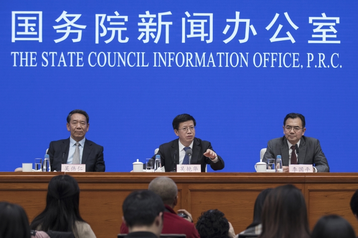"In this Jan. 14, 2019, photo released by Xinhua News Agency, Wu Yanhua, center, vice chairman of the China National Space Administration speaks during a press conference on Chang'e-4 mission, at the State Council Information Office in Beijing. China is accusing the U.S. of having ""weaponized"" visa issuance following the reported inability of a top Chinese space program official to obtain permission to travel to a key conference in Washington. Foreign Ministry spokeswoman Hua Chunying told reporters Wednesday, Oct. 23 that the head of the Chinese delegation to the International Astronautical Congress wasn't able to obtain a visa, making it difficult for Chinese representatives to attend important events at the meeting. (Jin Liwang/Xinhua via AP)"