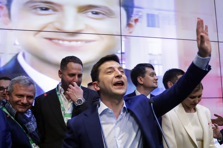 FILE - In this April 21, 2019, file photo, then-presidential candidate Volodymyr Zelenskiy greets his supporters at his headquarters after the second round of presidential elections in Kvyv, Ukraine. More than two months before the phone call that launched the impeachment inquiry into President Donald Trump, Ukraine's newly elected leader was already worried about pressure from the U.S. president to investigate his Democratic rival Joe Biden. (AP Photo/Sergei Grits, File)