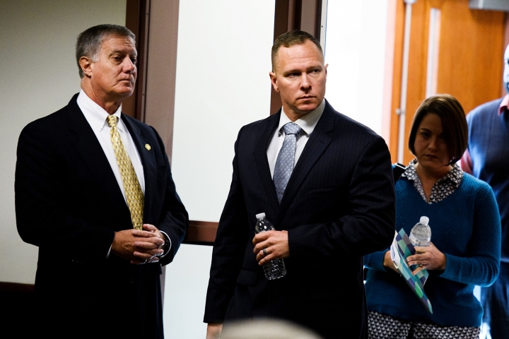 Suspended Greenville Sheriff Will Lewis enters the courtroom with his wife, Amy, Thursday afternoon, Oct. 24, 2019, in Greenville, S.C. Lewis, 43, said he did not plan to have sex with his young female assistant at an out-of-town budget conference, but one thing led to another after they went out for drinks and ended up in her hotel room.(Josh Morgan/The Greenville News via AP, Pool)