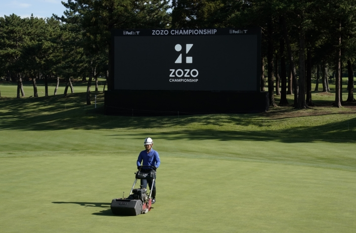 A member of grounds crew works on the 18th green before the start of the second round of the Zozo Championship PGA Tour at the Accordia Golf Narashino country club in Inzai, east of Tokyo, Japan, Saturday, Oct. 26, 2019. (AP Photo/Lee Jin-man)