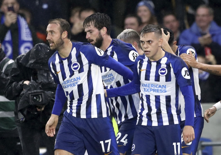 Brighton and Hove Albion's Glenn Murray, left, and Leandro Trossard celebrate Everton's Lucas Digne scoring an own goal during the English Premier League soccer match between Brighton and Hove Albion and Everton at the AMEX stadium, Brighton, England. Saturday, Oct. 26 2019 (Gareth Fuller/PA via AP)