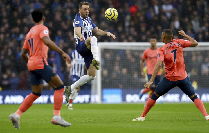 Brighton and Hove Albion's Dale Stephens controls the ball in the air during the English Premier League soccer match between Brighton and Hove Albion and Everton at the AMEX stadium, Brighton, England. Saturday, Oct. 26 2019 (Gareth Fuller/PA via AP)