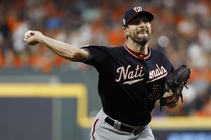 Washington Nationals starting pitcher Max Scherzer throws against the Houston Astros during the first inning of Game 1 of the baseball World Series Tuesday, Oct. 22, 2019, in Houston. (AP Photo/Matt Slocum)