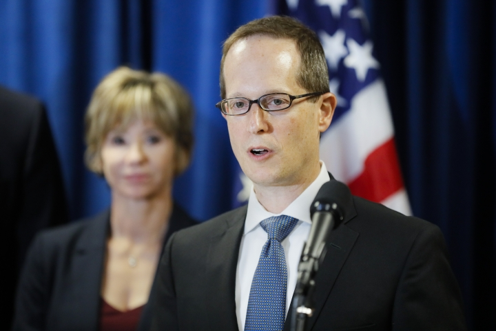 FILE - In this July 18, 2019 file photo Benjamin Glassman, United States Attorney of the Southern District of Ohio, speaks during a news conference in Cincinnati. Glassman has resigned effective Nov. 1. He is stepping aside for Republican President Donald Trump's pick, veteran prosecutor David DeVillers. DeVillers is a former Franklin County prosecutor and a Columbus-based assistant U.S. attorney for 17 years. (AP Photo/John Minchillo, File)