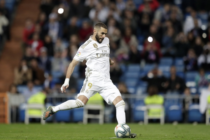 Real Madrid's Karim Benzema prepares to shoot to score his side's fourth goal from a penalty kick during a Spanish La Liga soccer match between Real Madrid and Leganes at the Santiago Bernabeu stadium in Madrid, Spain, Wednesday, Oct. 30, 2019. (AP Photo/Bernat Armangue)
