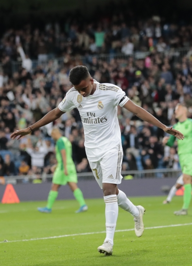 Real Madrid's Rodrygo celebrates after scoring the opening goal during a Spanish La Liga soccer match between Real Madrid and Leganes at the Santiago Bernabeu stadium in Madrid, Spain, Wednesday, Oct. 30, 2019. (AP Photo/Bernat Armangue)